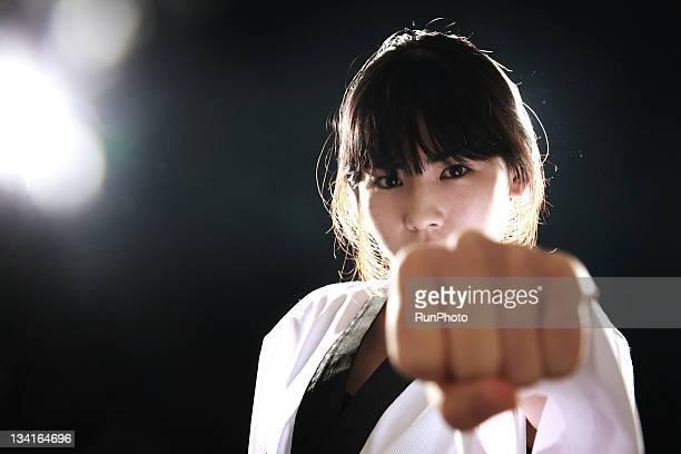 young woman training,taekwondo