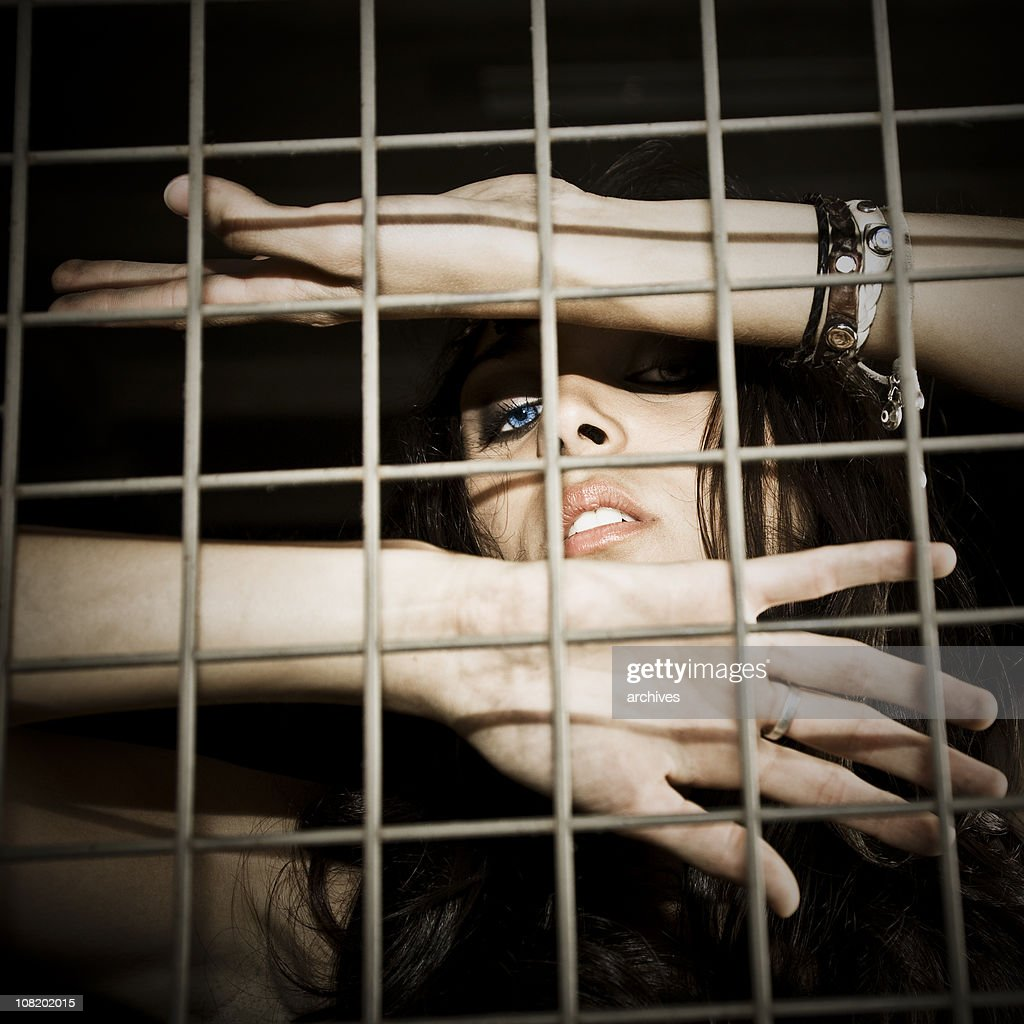 Young Woman Trapped in Steel Cage : Stock Photo