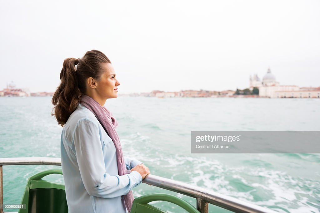 Young woman travel by vaporetto in venice, italy : Stock Photo