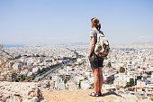 Young woman looking on a big city, travel concept