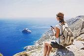 Young woman traveler using smart phone