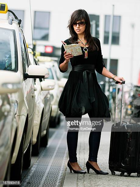 Young Woman Traveling and Taxis