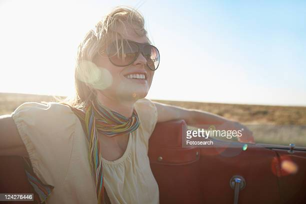 Young woman traveling in convertible