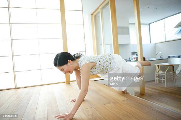Young woman tripping over step