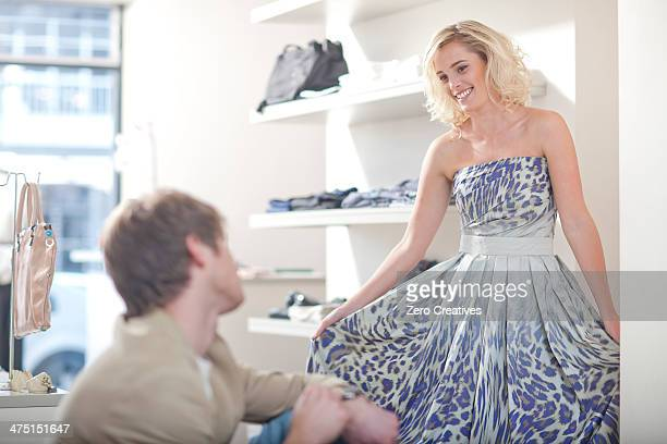 Young woman trying on dress