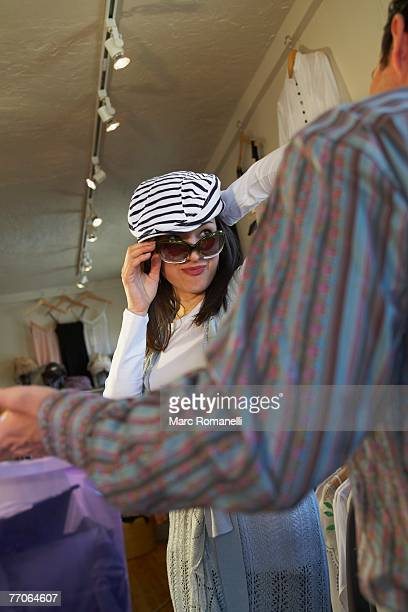 Young woman trying on sunglasses in a store
