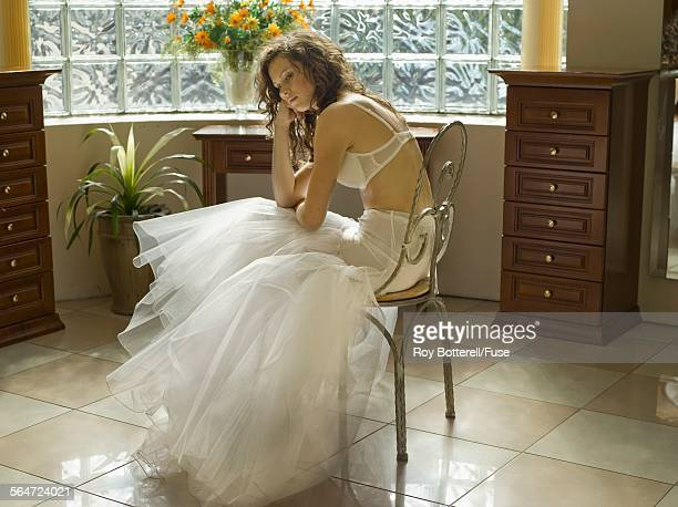 Young Woman Trying on Wedding Dress