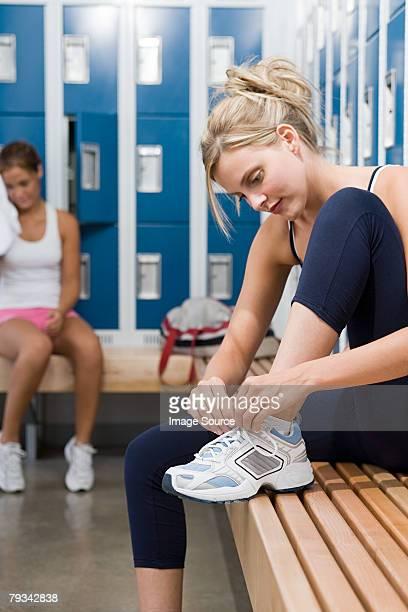 Young woman tying shoelace