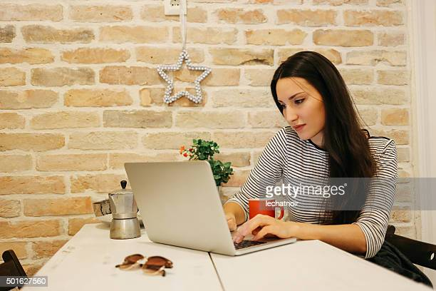 Young woman typing at the laptop
