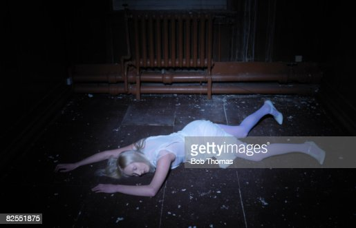 Young Woman Lying on Floor : Stock Photo