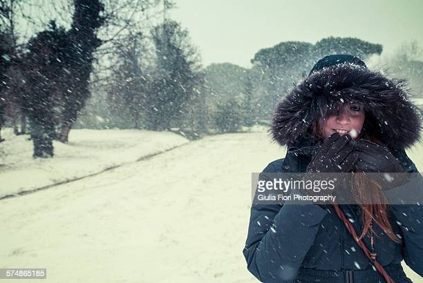 Young woman under the snow