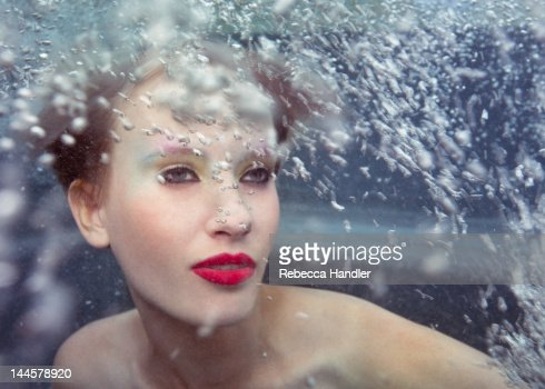Young woman under water with bubbles : Stock Photo