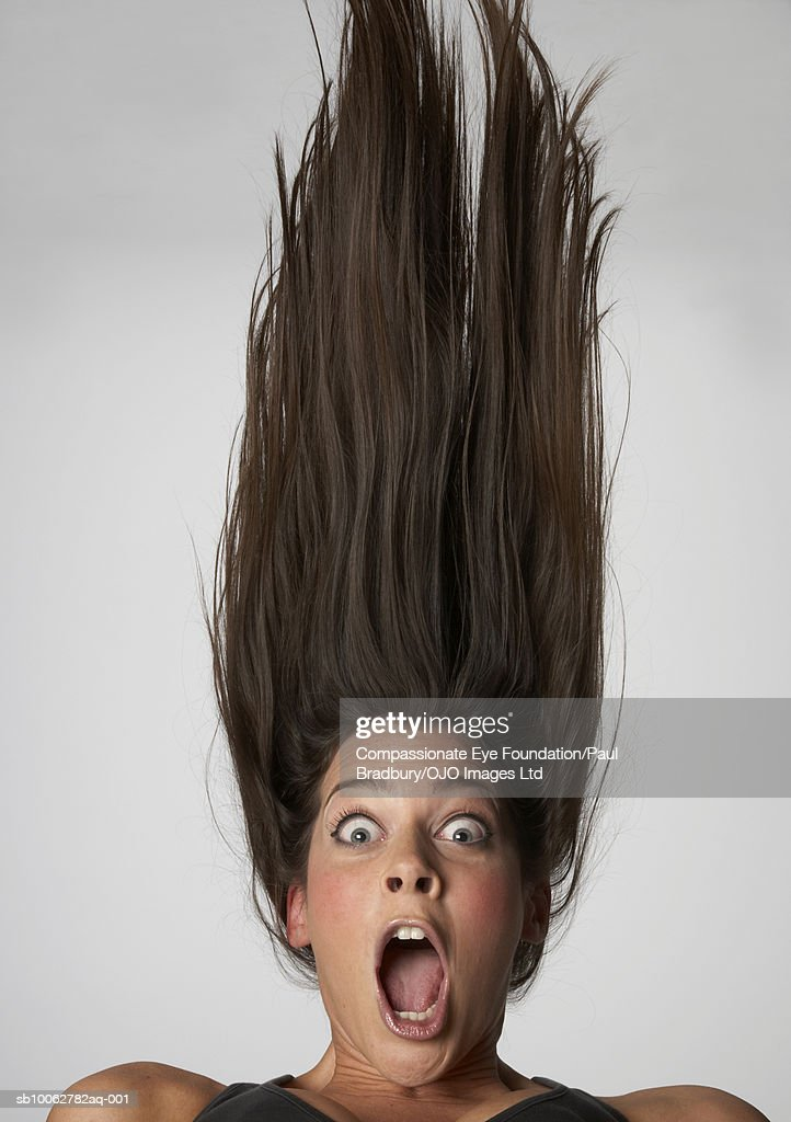 Young woman upside down, yelling, portrait : Stock Photo