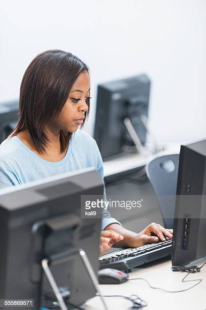 Young woman using a desktop computer