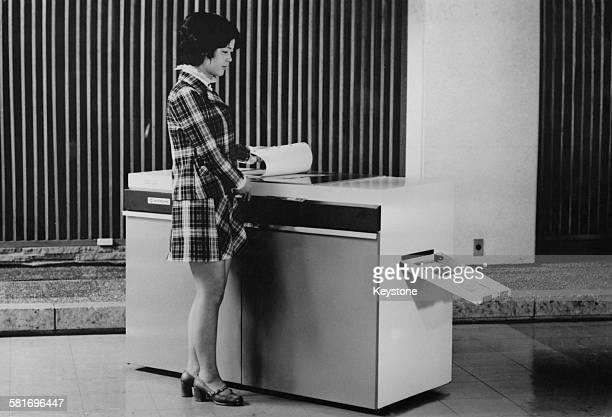 A young woman using a Hitachi colour photocopier Tokyo Japan 25th May 1972