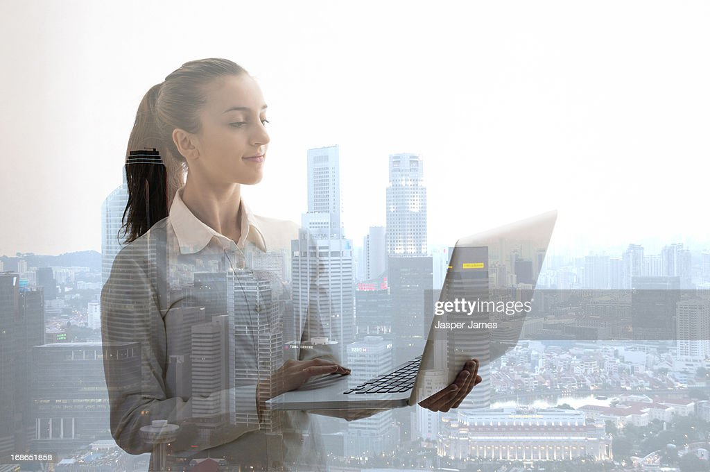young woman using a laptop : Stock Photo