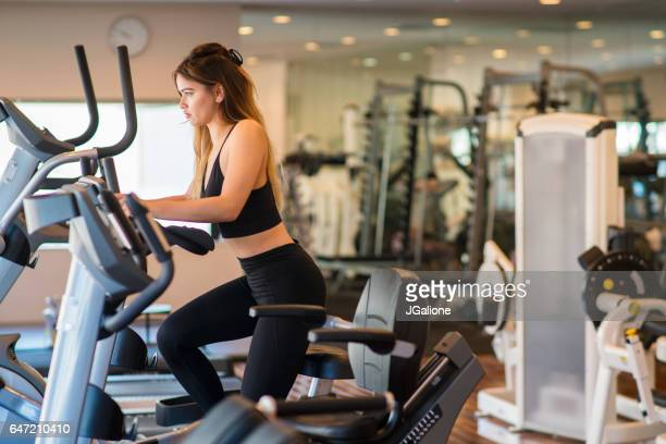 Young woman using an exercise bike