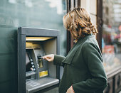 Young woman using a cash machine