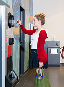 young woman using bottle deposit point