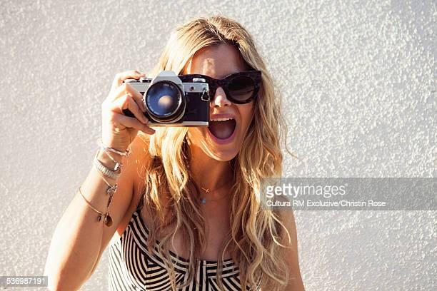 Young woman using camera
