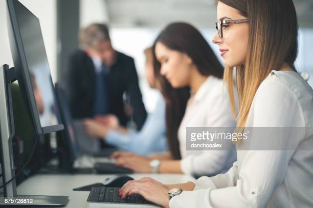 Young woman using computer at work
