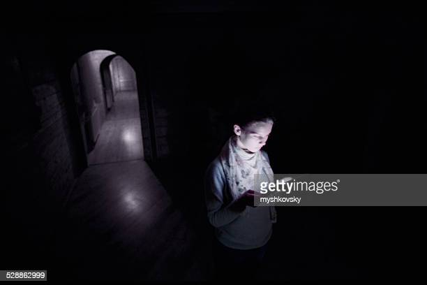 Young woman using digital tablet at night
