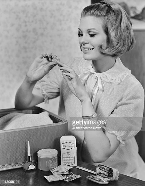 A young woman using Dorothy Gray hand and nail products circa 1960