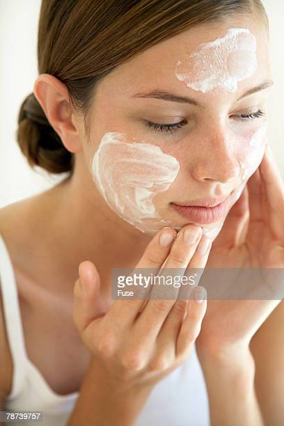 Young Woman Using Face Cream
