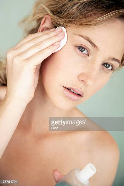 Young Woman Using Facial Cleanser