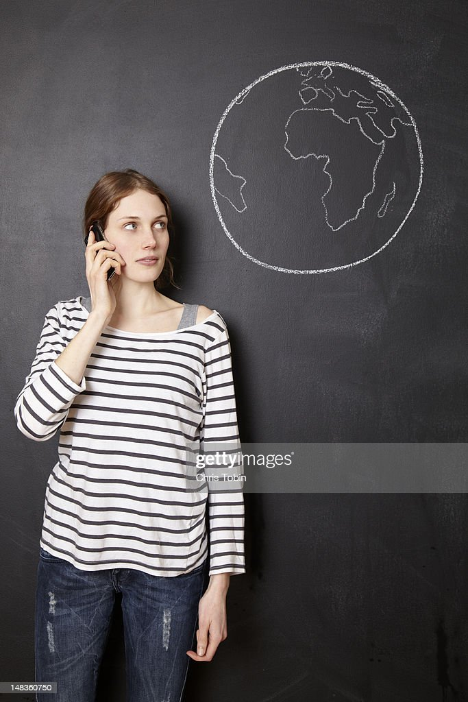 Young woman using her telephone : Stock Photo