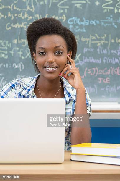 Young woman using laptop at desk