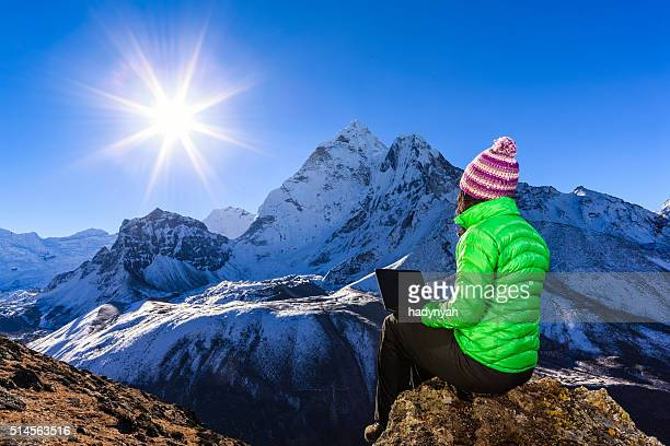Young woman using laptop in Himalayas, Nepal