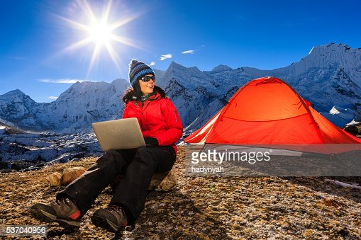 Young woman using laptop in Himalayas, Nepal : Stock Photo