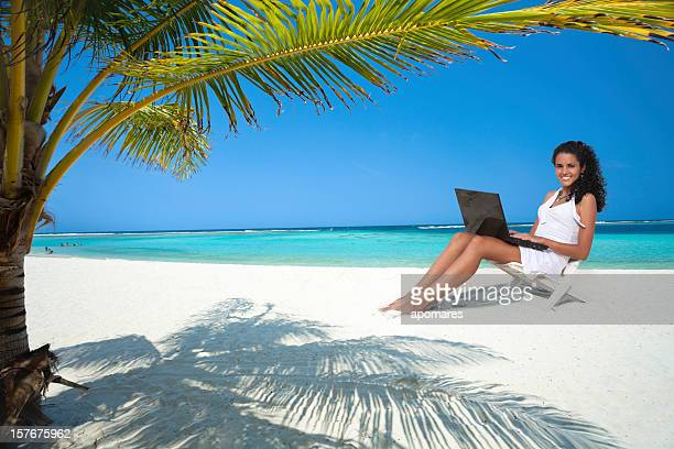 Young woman using laptop in the perfect place to work