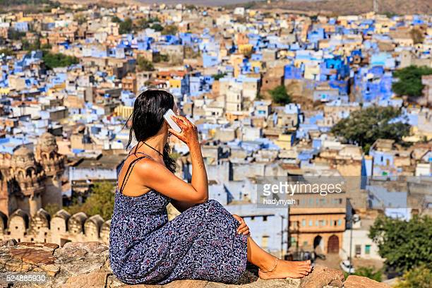 Young woman using mobile phone, Jodhpur, India