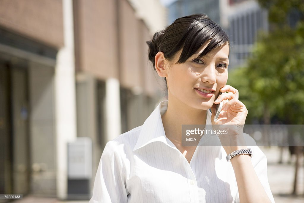 Young woman using mobile phone : Stock Photo