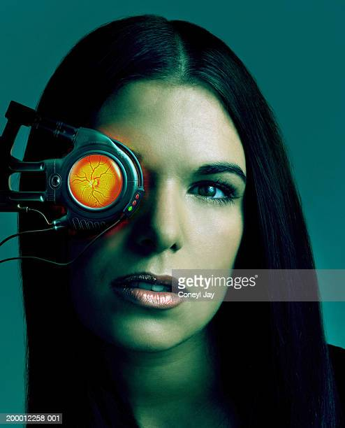 Young woman using retina scanner, portrait (Digital Composite)
