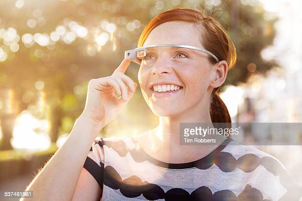 Young woman using smart glass.