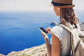 Young woman using smart phone on vacations, travel concept