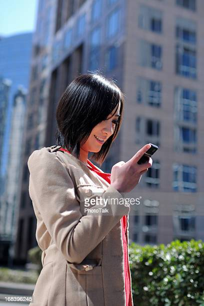 Young Woman Using Smart Phone - XLarge