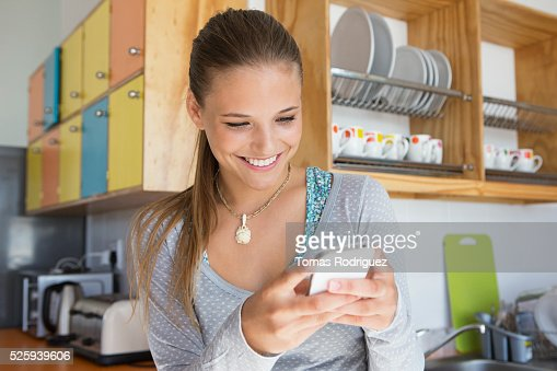 Young woman using smartphone : Photo