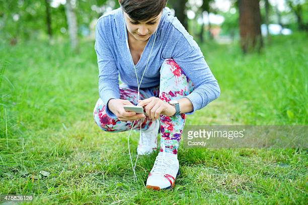 Young woman using smartwatch