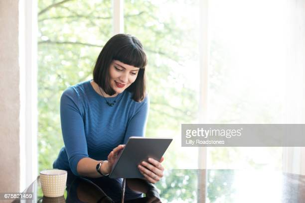 Young woman using tablet computer