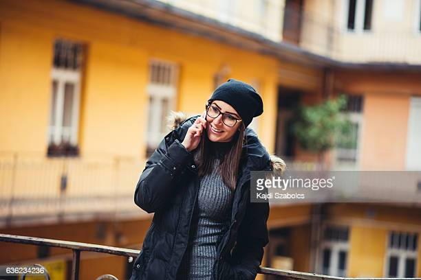 Young woman using the phone in apartment