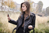 Shot of a girl holding the smartphone