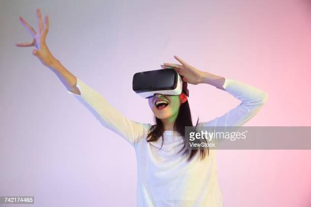 Young woman using virtual reality headset