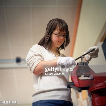 Young Woman Using Vise