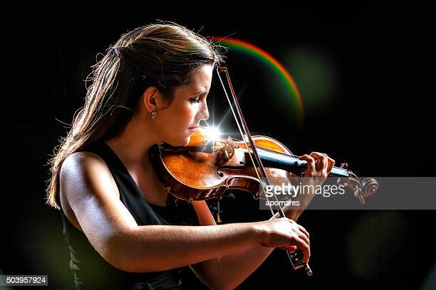 Young woman violinist player during presentation