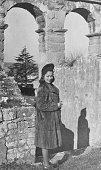 Young woman visiting Colosseum in Rome in 1939