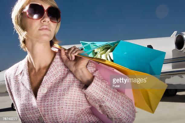 Young Woman Waiting at Airport Runway